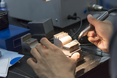 energy work: The specialist operator use the laser welding machine.The hi-precision welding process .