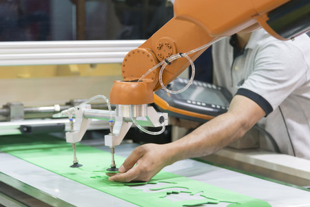 The technician operator adjust the automatic robot arm. Industrial 4.0 concept.Modern technology for manufacturing