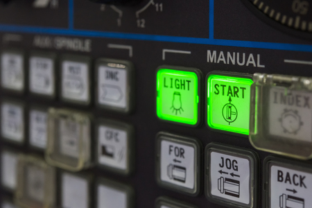 milling center: The CNC machine keyboard with the lighting.The START button on the CNC keyboard. Stock Photo