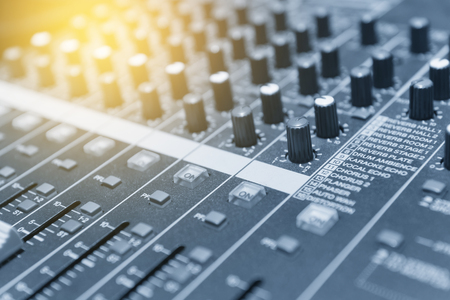 adjuster: The mixer table or fader board for music production in light blue scene with the lighting effect