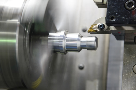 CNC lathe machine (Turning machine) cutting the metal  screw thread part .Hi-precision CNC machining concept. 스톡 콘텐츠