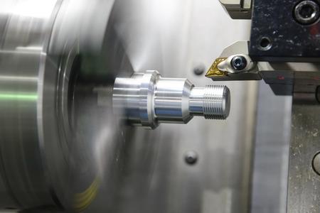 CNC lathe machine (Turning machine) cutting the metal  screw thread part .Hi-precision CNC machining concept. Standard-Bild