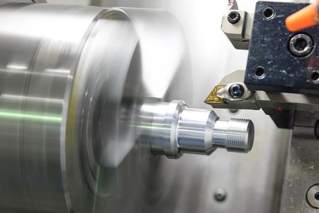 CNC lathe machine (Turning machine) cutting the metal  screw thread part by lathe cutter .Hi-precision CNC machining concept. 스톡 콘텐츠