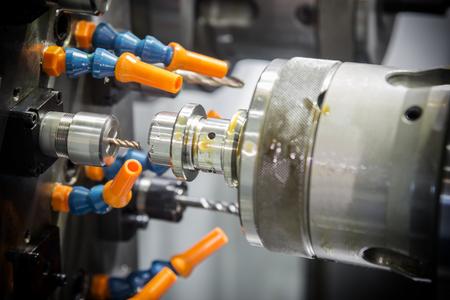 CNC lathe machine or Turning machine drilling  the steel rod .Hi technology manufacturing process. Stock Photo