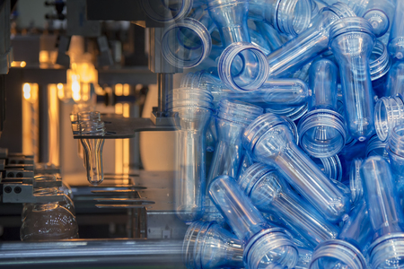 Abstract scene of  blowing bottle process  and raw material for plastic bottle blowing process .The sample of  injection process. Banco de Imagens