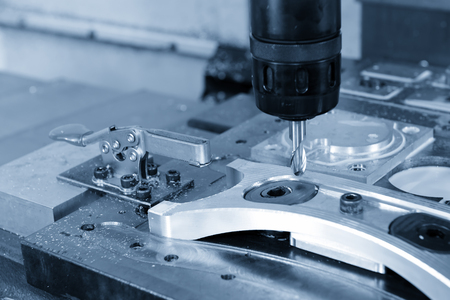 The CNC milling machine cutting the automotive part with the rough end Mill tool. Hi-precision CNC machining concept.