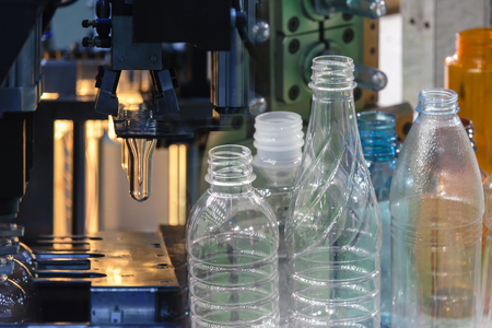Abstract scene of  blowing bottle process  and  plastic bottle product.The Plastic bottle manufacturing process.