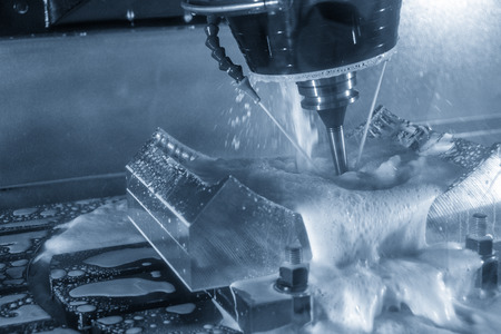 The 5 axis CNC machine cutting the automotive part with the solid ball end mill.