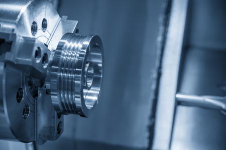 CNC lathe machine cutting the metal  screw thread part. Stock Photo