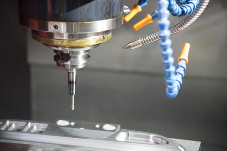 The CNC milling machine cutting the mold parts.The injection mold manufacturing process.