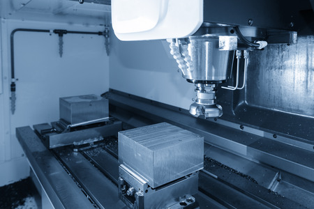 The CNC milling machine cutting the raw material by the face milling tool. Stok Fotoğraf - 97915149