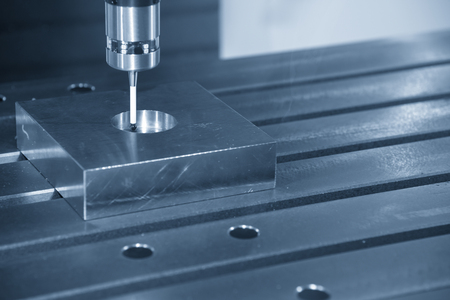 The CNC machine attach the CMM probe measure the dimension of circular hole.