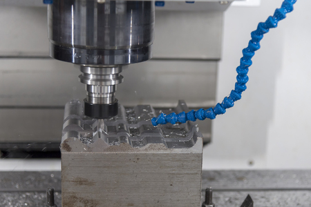 The CNC milling machine cutting the mold part with the solid ball end mill.