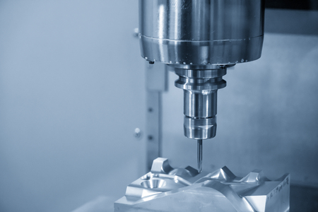 The CNC milling machine cutting the  automotive mold part with the solid ball endmill tool. Modern manufacturing process. Reklamní fotografie