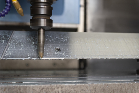 The CNC milling machine cutting the tire mold part with the solid ball end-mill tool and coolant. 스톡 콘텐츠
