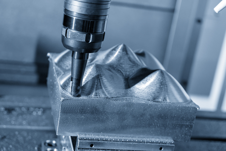 The CNC milling machine cutting the mold part in roughing  process.Hi-technology manufacturing process.