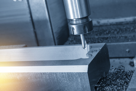 The CNC milling machine drilling the hole at tire mold part with the center drill tool.