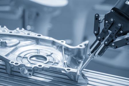 The robot for manufacturing  the aluminum automotive part .The automotive part quality control concept. Stok Fotoğraf