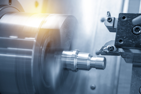 The CNC lathe or turning machine cutting the thread at end of aluminum shaft part.Hi-technology manufacturing process.