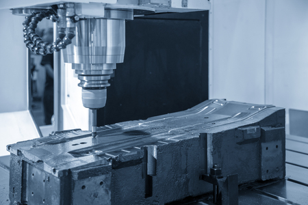 The CNC milling machine cutting the injection mold part with the solid ball endmill tool.The precision mold cutting .