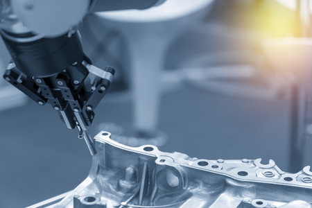 The robotic arm catch the steel plug for manufacturing process .The hi-technology for automotive manufacturing process.