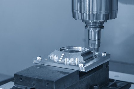 The CNC milling machine cutting the injection mold part by solid ball end mill tool.Mold manufacturing process.