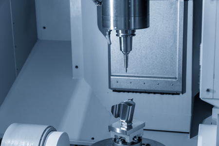 The 5-axis CNC milling machine cutting   automotive part with the solid ball endmill tool. The Hi-Technology manufacturing process.