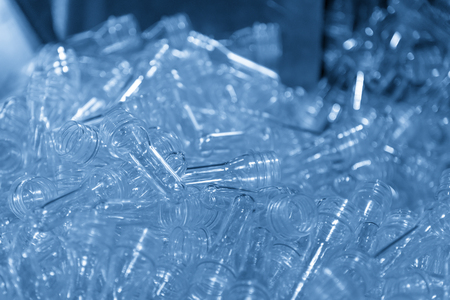 The preform shape of PET bottle for blowing plastic bottle process in the light blue scene.Drinking water container manufacturing processing. 写真素材