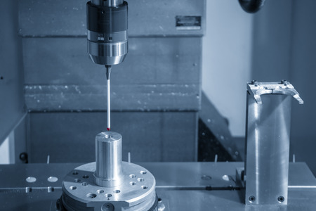 The touching probe attach on CNC machine setting the work pieces. The quality control on CNC milling machine.