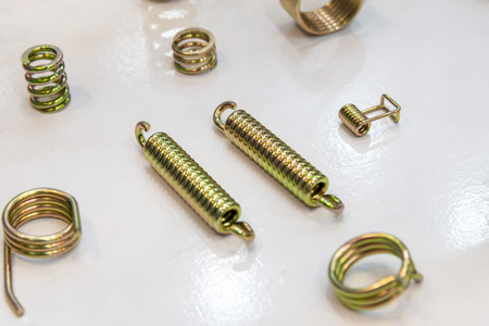 The various type of wire spring spare parts on the white background. The industrial spare parts.