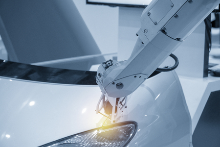 The robotic arm with the scanning probe measure automotive part.The reverse engineering process of automotive parts.