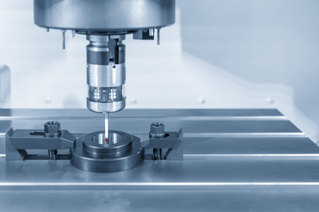 The touch probe attach on the CNC milling machine for calibration process with ring gage. The CMM measuring process.