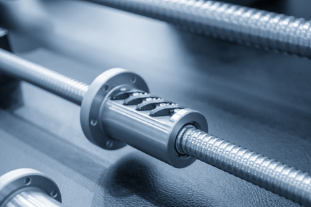 Closeup the lead screw spare parts assembly with bearing of the CNC machine. The hi-precision part of CNC machine manufacturing process. Stockfoto