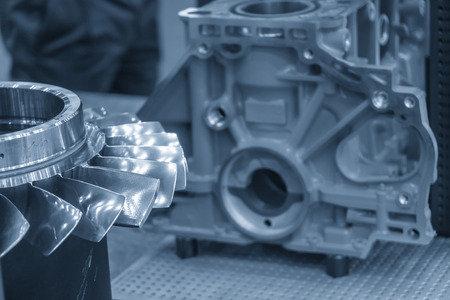 The impeller parts with the cylinder block background. The boats engine manufacturing concept.