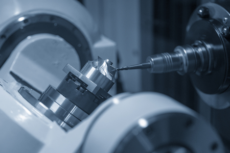 The 5-axis machining centre cutting the aluminium turbine  part with ball  endmill tool. The 5 axis CNC milling machine cutting  automotive part. Stock Photo