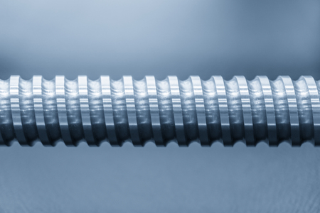 Close-up of the lead screw parts of the CNC machine. The hi-precision part of CNC machine manufacturing process. Stock Photo