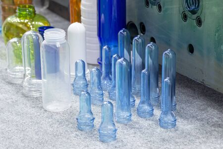 The plastic products, preform shape and bottles with the injection mold . The collection of various type preform shape of plastic bottles. Stock Photo - 126560875