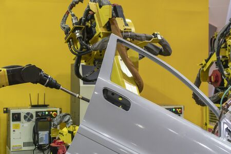 The spot welding the automotive parts by  the robotic arm. The hi-technology  automobile assembly line production concept . Stock Photo
