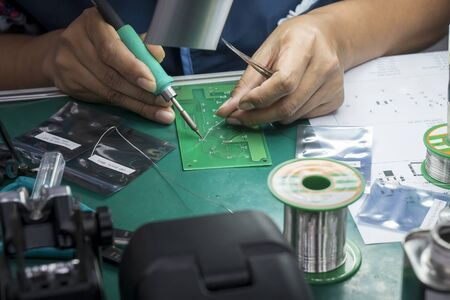 The  soldering operator repair the electronics circuit board. The electronic circuit board soldering process by skill operator.