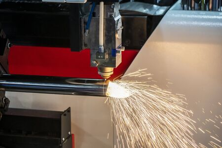 The CNC fiber laser cutting machine cutting the stainless tube. The sparking light from the fiber laser cutting machine.