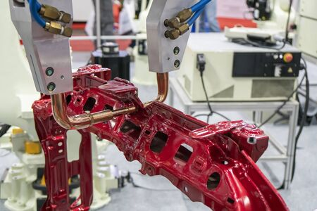 The robotic for spot welding the automotive frame parts. The hi-technology  automobile assembly manufacturing process.