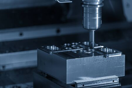 The CNC milling machine cutting mould parts with the solid endmill tool. The mold and die manufacturing process by machining center. Stock Photo