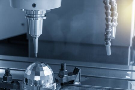 The CNC milling machine cutting the precision parts by small ball endmill tool The micro cutting concept. Banco de Imagens