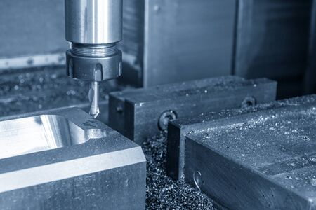 The CNC milling machine drilling the centre drill at the mould parts. The injection mould manufacturing process with the machining centre. Banco de Imagens