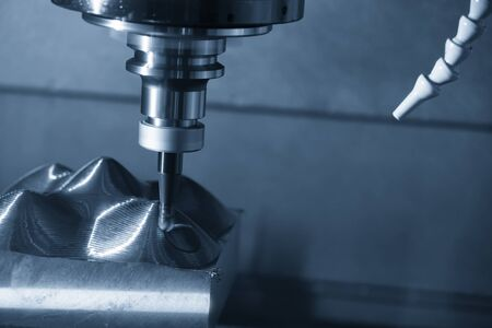 The CNC milling machine rough cutting the mould parts with indexable ball endmill tool.The mould and die manufacturing process by machining center.