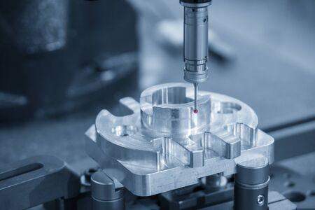 The Coordinate Measuring Machine,CMM machine measure the aluminium parts. The automotive parts quality control processing by CMM machine.