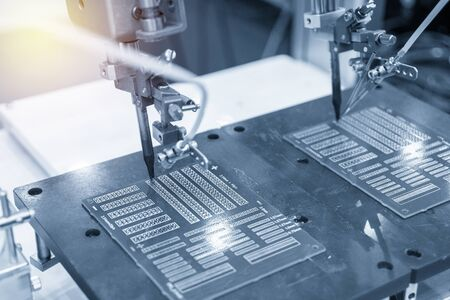 The soldering robotic system in the electronic factory. The hi-technology manufacturing process by automatic soldering system. Stock Photo