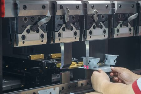 The hydraulic bending machine operation by technical operator. The sheet metal manufacturing process by hydraulic bending machine.