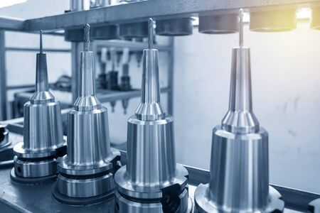 The collection of cutting tools of machining centre. The solid ball end mill tool in the holder.