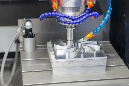 The CNC milling machine cutting the aluminium parts with solid ball endmill tools. The mould and die manufacturing process by machining center. Stock Photo